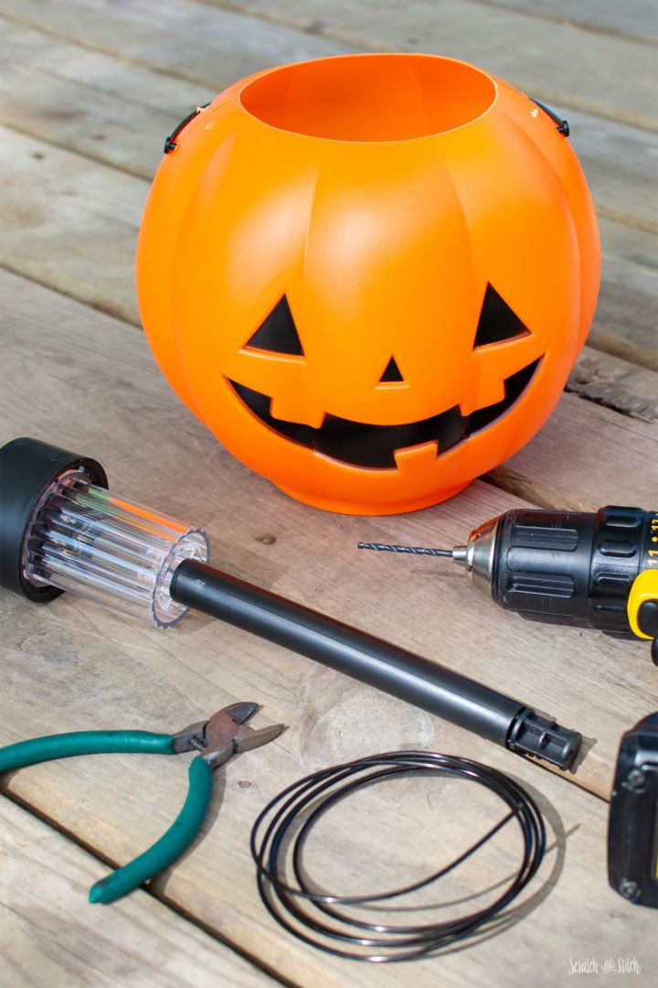 DIY Halloween Lights made with Pumpkin Trick or Treat Pails by Scratch and Stitch